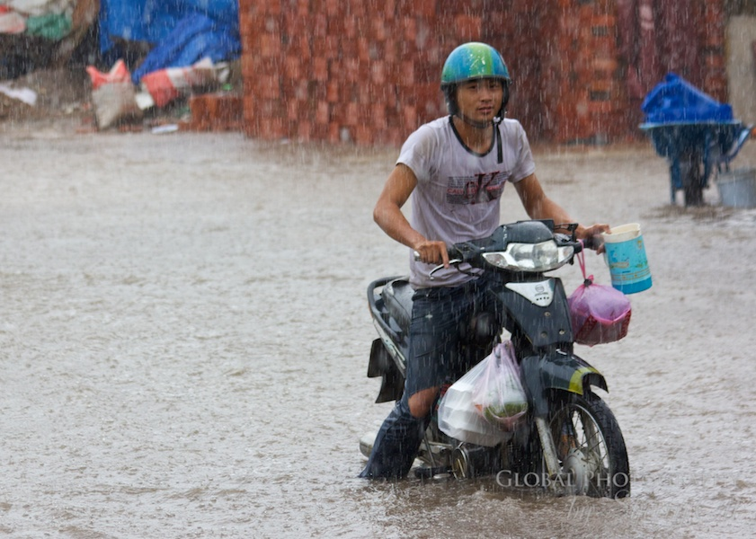 Stuck in the street flood – but still a smile on his face!