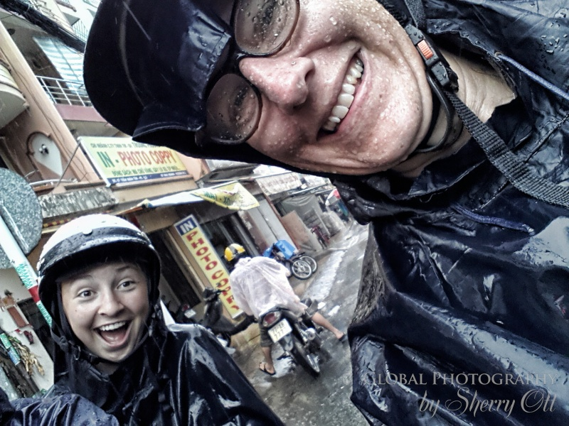 Evie and I on the back of our motorbikes enjoying the rainy experience!