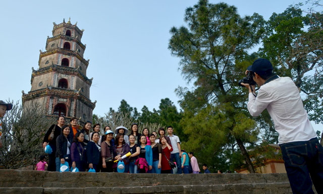 Tourists pose for a photo in front of Thien Mu pagoda in Hue City, Vietnam. MindaNews photo by Lorie Ann Cascaro