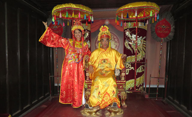 Authors Lorie and Jesse dress up as Vietnamese royalty in an old room in Tu Duc Tomb. MindaNews photo